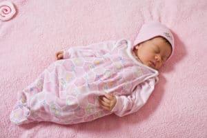 newborn baby in sleep suit