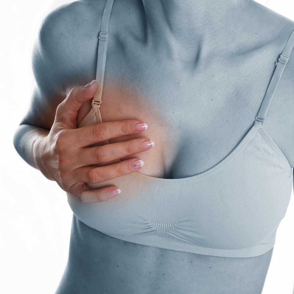 blocked milk duct causes breast pain